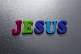 jesus word spelled out using colored fridge magnets
