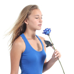 Beautiful woman holding and smelling a blue rose