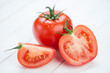 Ripe tomato and its segments, close-up