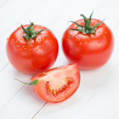 Vegetables: fresh tomatoes on wooden boards
