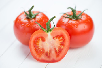 Horizontal shot of fresh red tomatoes, close-up