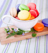 colorful macarons in a small cup