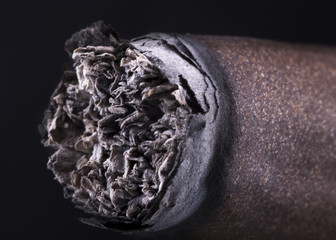 macro of Cigar over black background