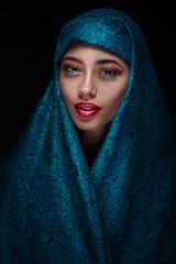 Portrait of a beautiful woman in paranja