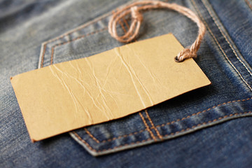 Jeans with blank paper label on a string