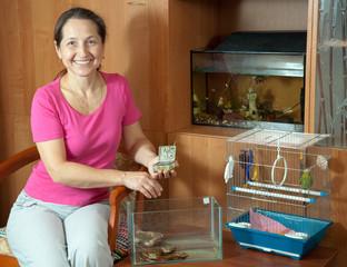 Woman feeding pets