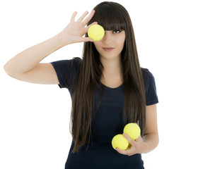 Woman tennis player holding a racket and balls, isolated on a wh