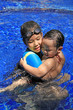 Sister embrace her brother in swimming pool
