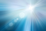 Sun on a blue sky with rays and flare