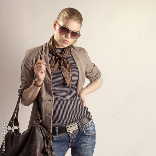 Fashion outfit girl portrait. Shopping woman posing in studio