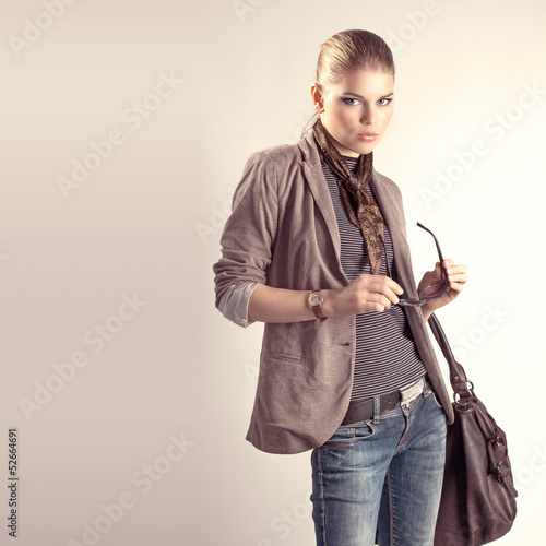 Beautiful fashion studio portrait of pretty blond woman