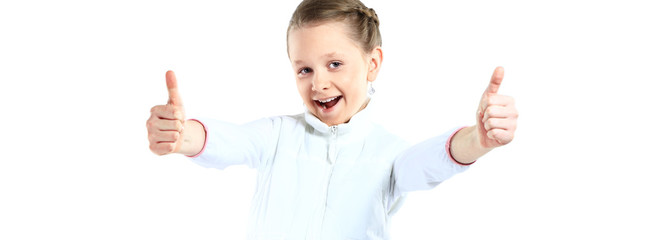 Little girl showing two thumbs up isolated on white background