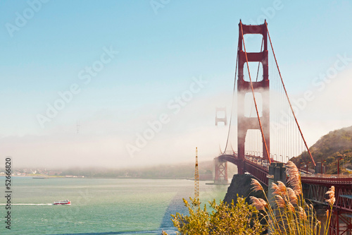 Golden Gate Bridge with clouds and blue sky. San Francisco. USA.