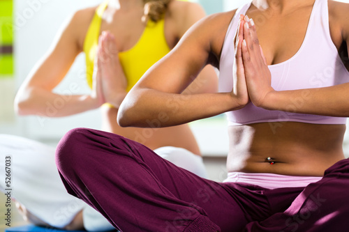 women in the gym doing yoga exercise for fitness - 52667033