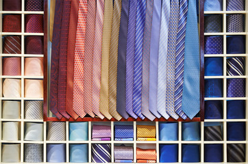 Ties collection on the shelf of a shop