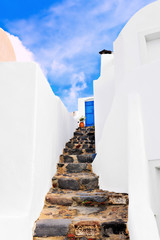 Staircase of a traditional whitewashed house in Oia