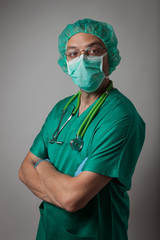Portrait of a young physician with surgical mask