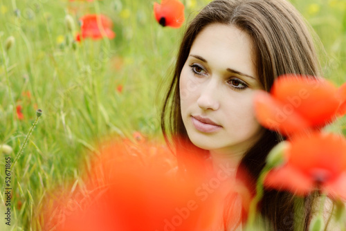 pensive girl in poppies field