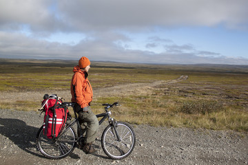 girl cyclist on the background of the tundra