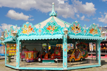 Cyan and white carousel in amusement park