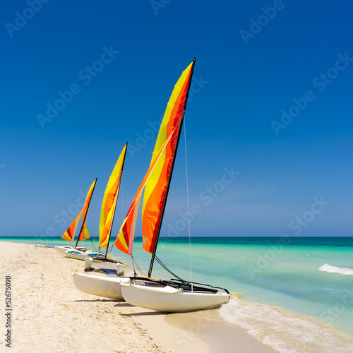 Colorful sailing boats on a cuban beach