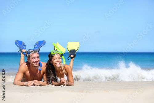 Beach travel couple having fun snorkeling looking