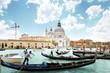 gondolas on Canal and Basilica Santa Maria della Salute, Venice,