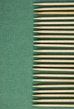 wooden toothpicks on the green background