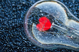 Love concept - red heart of an electric bulb