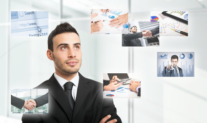 Businessman looking to business related images