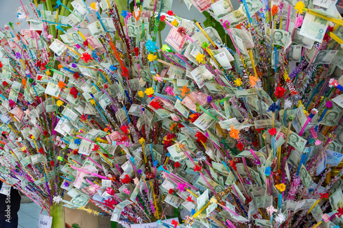 Thai people make a donation tree in Visakha Bucha day.
