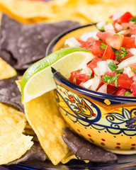 Bowl of spicy salsa and corn chips