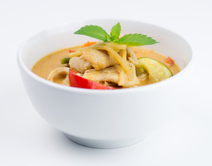 Bowl of Thai chicken red curry isolated on white background