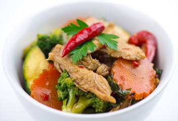 Closeup of spicy chicken Thai basil with seasonal vegetables