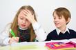 schoolchildren writing at school