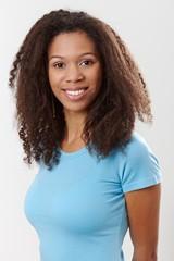 Portrait of beautiful ethnic girl smiling