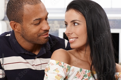 Loving couple looking at each other smiling