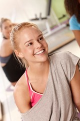 Portrait of beautiful athletic girl smiling