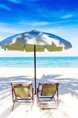 Two chairs and umbrella on stunning tropical beach, Thailand