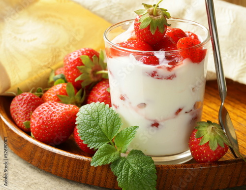dairy dessert - yogurt with fresh strawberries in a glass