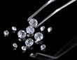 Beautiful shining crystal (diamond) in the tweezers,
