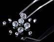 Beautiful shining crystal (diamond) in the tweezers,