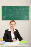 Portrait of teacher woman working in classroom