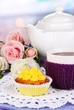 Delicious beautiful  cupcake on dining table on room background