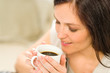 Cute woman holding cup of hot coffee