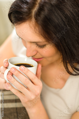 Relaxing woman drinking hot beverage for enjoyment