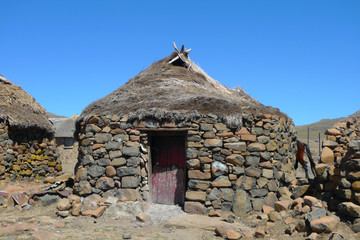 Traditional style of housing in Lesotho at Sani Pass