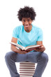 Young black teenage student men reading a books - African people