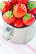 Fresh red strawberries in an old cup