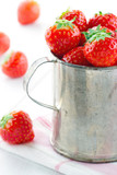 Fresh red strawberries in a metal cup